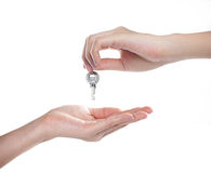 Hand holding keys. Hands and key isolated on white background Stock Photography