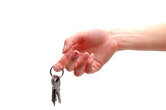 Hand holding keys. On a white background Stock Image