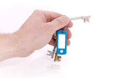 Hand holding keys Stock Photo