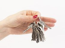 Hand holding a keys Royalty Free Stock Photos
