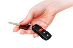 Hand holding keys isolated Stock Photo