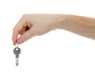Hand holding keys isolated on a white background Royalty Free Stock Photography