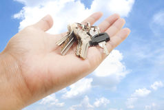 Hand and keys. Hand holding keys with pretty sky background Stock Photos