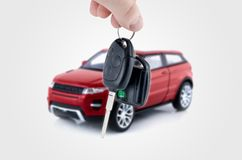 Hand holding keys to new car. Stock Image