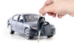 Hand holding keys to new car. Buy or selling composition Stock Photo