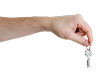 Hand holding keys on a white Stock Photography
