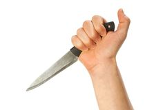 Hand holding knife. Isolated over white background royalty free stock photo