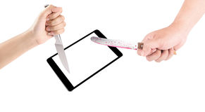 Hand holding a knife stabbed a tablet isolated on a white backgr Stock Photo