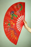 Hand holding large Chinese fan Royalty Free Stock Image