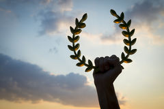 Hand Holding Laurel Wreath Sunset Sky Royalty Free Stock Images