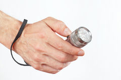 Hand holding a led flashlight on white background Stock Photo