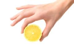 Hand holding lemon Royalty Free Stock Images