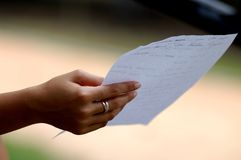 Hand holding letter Royalty Free Stock Image