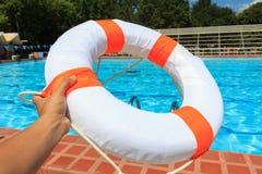 Hand holding Life buoy Royalty Free Stock Photos