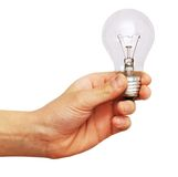 Hand holding a light bulb Stock Photography