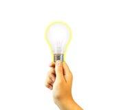 Hand holding light bulb. Isolated on white Stock Photo