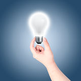Hand holding light bulb Royalty Free Stock Image