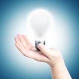Hand holding light bulb Royalty Free Stock Photos