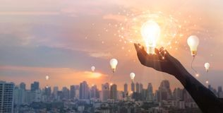 Free Hand Holding Light Bulb And Brain And Network Connection On City Background, Idea And Imagination, Creative And Inspiration. Royalty Free Stock Images - 167606779