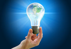 Hand holding light bulb globe Royalty Free Stock Photos