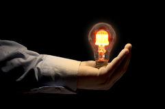 Hand holding light bulb Royalty Free Stock Photography
