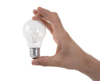 Hand holding an light bulb Stock Photos