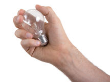 Hand holding an light bulb Stock Images