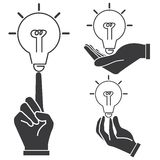 Hand holding light bulb Stock Images