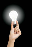 Hand holding light bulb symbolizing help, idea or inspiration Royalty Free Stock Photo