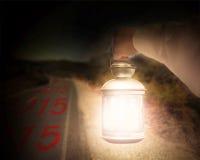 Hand holding light illuminating 2015 on dark road at night Royalty Free Stock Photo