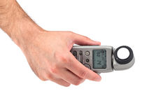 Hand holding a light meter Royalty Free Stock Photos