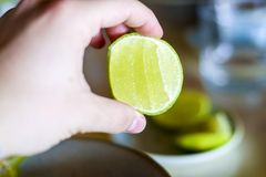 Hand holding lime wedge Royalty Free Stock Images