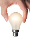 Hand holding lit bulb with no power cable Royalty Free Stock Photography