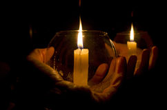 Candle in the Dark. A hand holding a lit candle in the dark Stock Photography