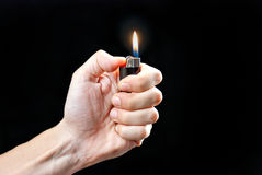 Hand Holding Lit Lighter Stock Photography