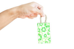 Hand holding little packet green recycle paper bag, isolated on white background Royalty Free Stock Photography