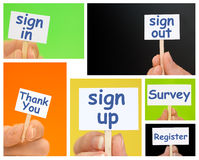 Hand holding Little Signs with online sign up, register and survey text Royalty Free Stock Photos