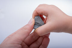Hand holding little stone in hand Stock Photos