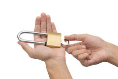 Hand holding, locking and unlocking brass padlock isolated Royalty Free Stock Photography