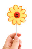 Hand holding lollipop Royalty Free Stock Images