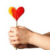 Hand holding lollipop heart Royalty Free Stock Image