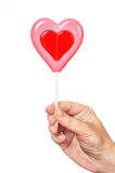 Hand holding lollipop heart Stock Photos