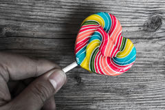 Hand Holding Lollipop Of Heart Shape Stock Images