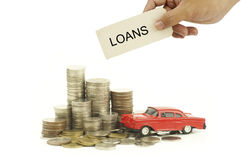 Hand holding lons sign over money Royalty Free Stock Images