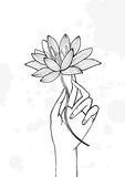Hand holding lotus flower. Contour hand drawn illustration. yoga, meditation, awakening symbol. Royalty Free Stock Image