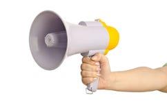 Hand holding loudspeaker. On white Stock Photography