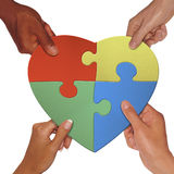 Hand holding love shape puzzle complete. Put a puzzle together to become love Royalty Free Stock Photos