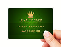 Hand holding loyalty card isolated over white Royalty Free Stock Images