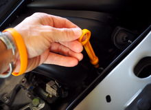 Hand holding lubricant oil level check dipstick Royalty Free Stock Photos