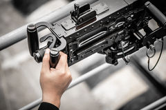 Hand holding on machine gun ship Royalty Free Stock Photos